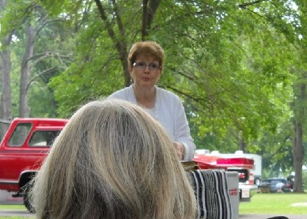 Pastor Judy Starting Sunday Morning Service in the Park